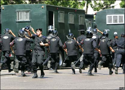 Riot police rush to their positions