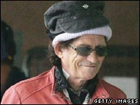 Keith Richards leaving hospital with hat on head