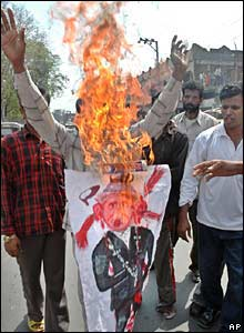 Protesters burning banners in Hyderabad 3 March 2006