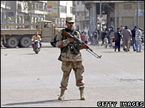 Iraqi soldier stands guard during curfew in Baghdad