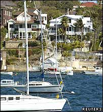 Luxury houses with multi-million dollar price tags tower over Sydney Harbour in this September 19, 2003 file photograph.