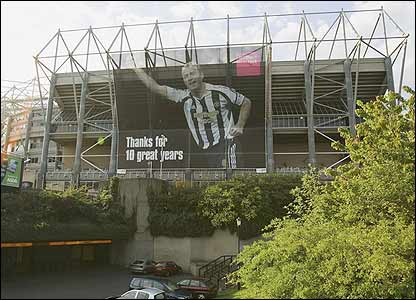 A huge banner of Alan Shearer hangs outside St James' Park