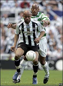 Jean-Alain Boumsong manages to shield the ball from Celtic's Dion Dublin