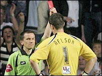 Brentford keeper Stuart Nelson is red-carded during the 1-1 draw at Swansea