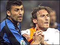 Francesco Totti (right) takes on Walter Samuel