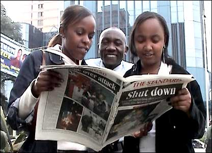 Kenyans reading the Friday edition of The Standard