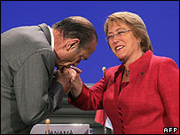 French President Jacques Chirac kisses Chilean President Michelle Bachelet at a summit in Vienna