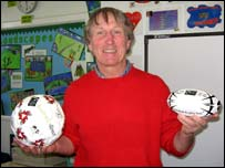 JPR Williams with fair trade footballs