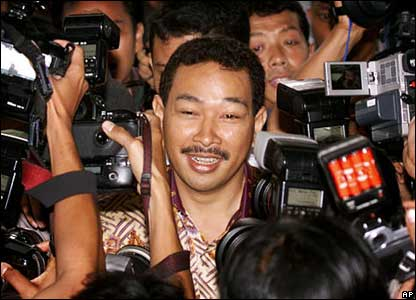 Hutomo Mandala Putra, popularly known as Tommy, youngest son Suharto, is mobbed by reporters on 3 October, 2000