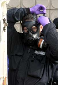 Police wearing gas masks returned to search the bar
