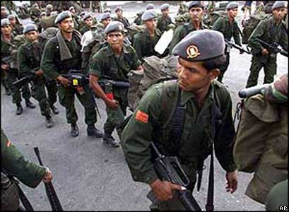 Indonesian soldiers leaving East Timor on 24 September, 1999
