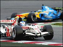 Jenson Button's Honda leads Giancarlo Fisichella's Renault in testing