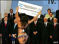 A protester in a bikini at a summit in Vienna