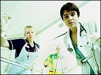 Staff around a hospital bed