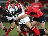 Jonny Bell is held up by the Munster defence