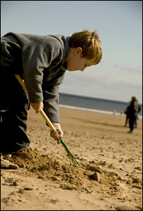 Child on beach at Scarborough North Bay