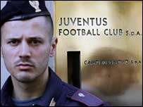 A policeman stands in front of Juventus' headquarter in Turin