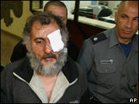 Haim Eliahu Habibi escorted by police