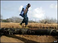 Man walks on pipeline at Atlas Creek