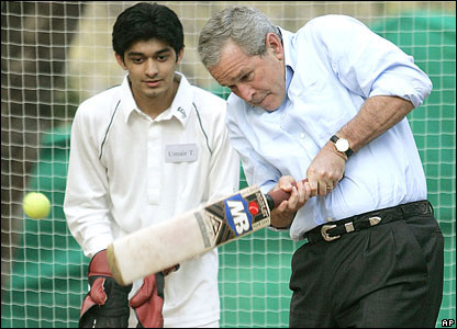 President Bush playing cricket during a workshop with boys at the US embassy in Islamabad
