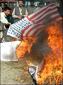 An American flag is burnt in an anti-Bush protest in Lahore, Pakistan