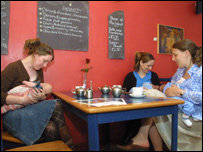 Women breastfeeding in a cafe