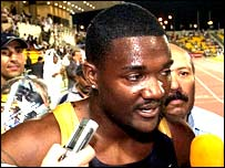 Justin Gatlin is mobbed by the press after breaking the world champion