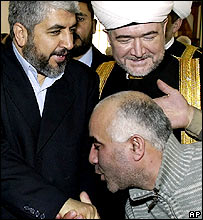 Khaled Meshaal (right) and Mufti Sheikh Ravil Gainutdin are greeted by worshippers at a Moscow mosque