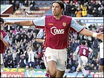 Milan Baros celebrates his winner for Villa