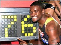 Justin Gatlin celebrates his new world record