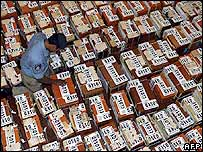 Policeman inspects ballot boxes in Suva, Fiji
