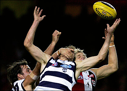 St Kilda's Nick Riewoldt (back) grabs a Geelong player round the neck