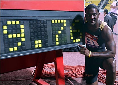 Justin Gatlin with the clock confirming a new world best in the 100m