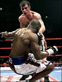 Jeff Lacy tumbles to the canvas under a Joe Calzaghe onslaught