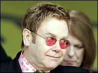 Sir Elton at a Watford football match