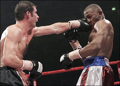 Calzaghe catches Lacy with a left hook