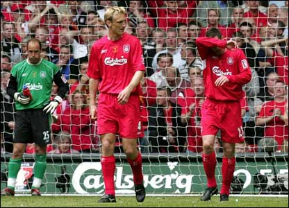 Jose Reina and Sami Hyypia look deflated as own goal-scorer Jamie Carragher covers his face