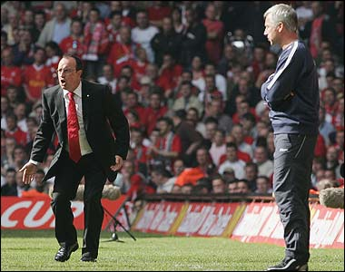 Rafael Benitez shouts from the touch-line as Alan Pardew looks on