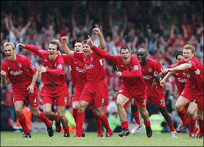 Liverpool players jump up in celebration