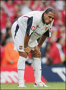 Anton Ferdinand looks distraught after his decisive penalty is saved