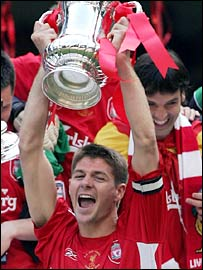 Liverpool captain Steven Gerrard lifts the FA Cup