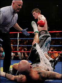 Ricky Hatton walks away after putting Collazo on the deck inside the first 15 seconds