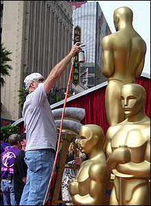 Man painting giant Oscar.