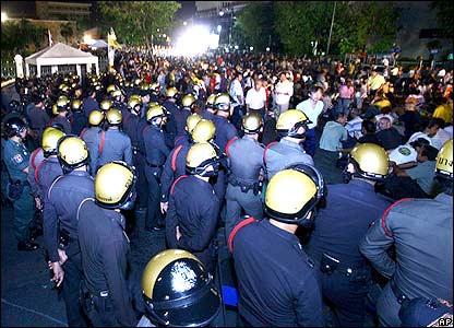 Demonstrators file past police during Bangkok protests.