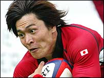 Daisuke Ohata dives to score his record-breaking try