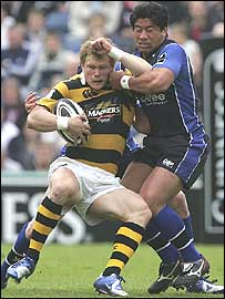 Wasps' Josh Lewsey is collared by Sale centre Elvis Seveali'i,