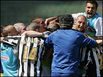Juventus celebrate after David Trezeguet scores against Reggina