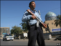 A policeman guards a Baghdad mosque