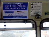CCTV warning sign and camera on school bus in Gloucestershire