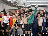 The Thistle players celebrate promotion